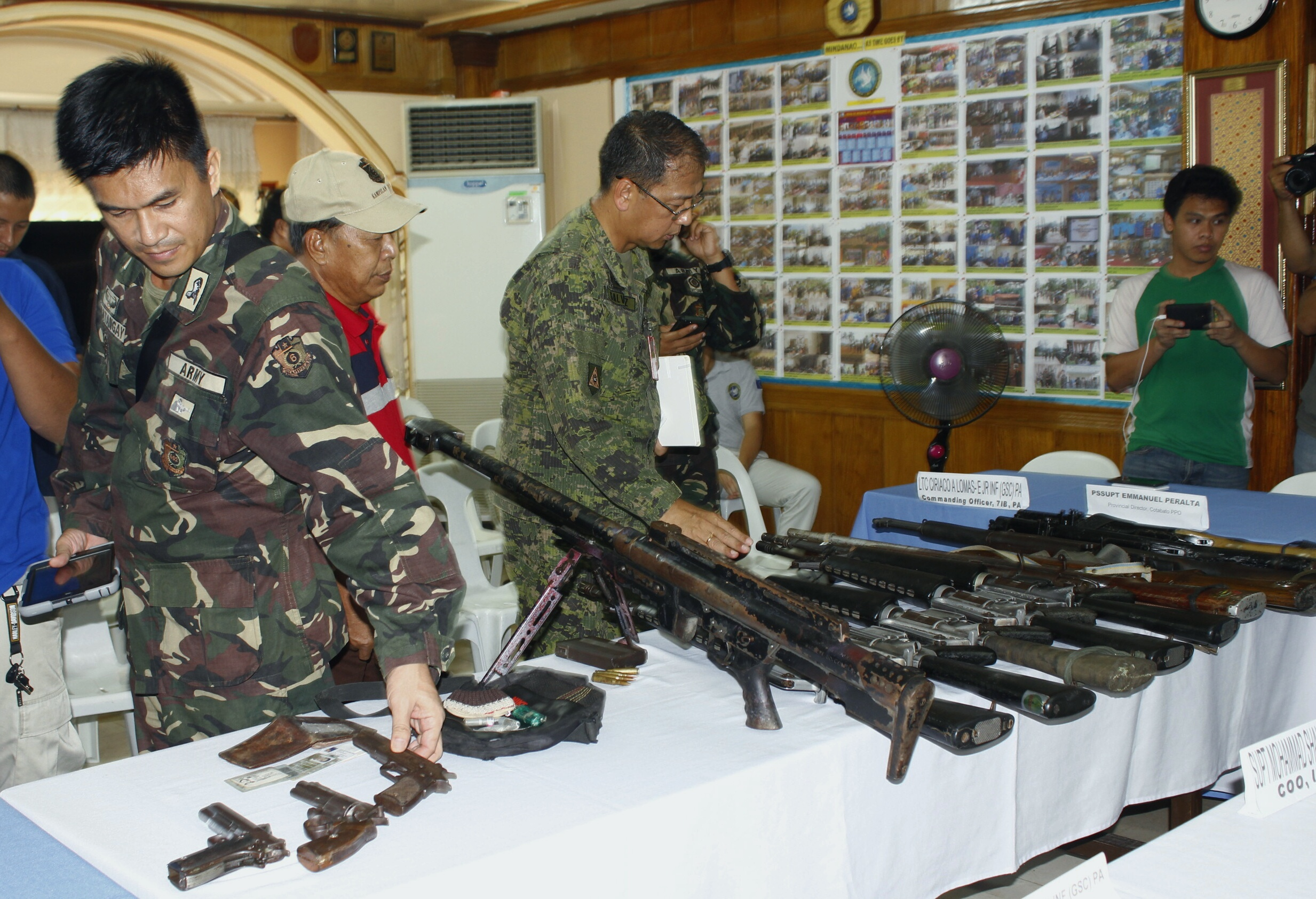 JOINT OPERATION. Authorities present firearms recovered during a joint anti-drug operation by the government and the MILF. All photos from the Office of the Presidential Adviser on the Peace Process
