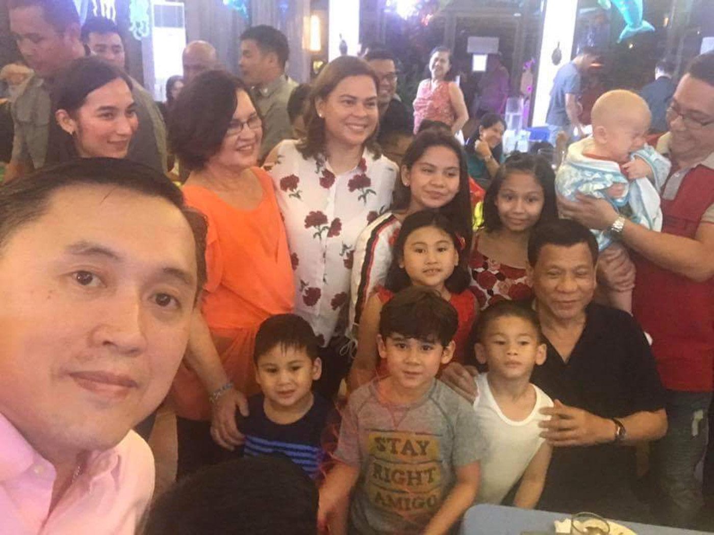 BIRTHDAY CELEBRATION. President Rodrigo Duterte and his grandchildren, ex-wife Elizabeth Zimmerman (in orange), Mayor Sara Duterte-Carpio, son-in-law Manases Carpio, and Secretary Bong Go. Photo by SAP Bong Go
