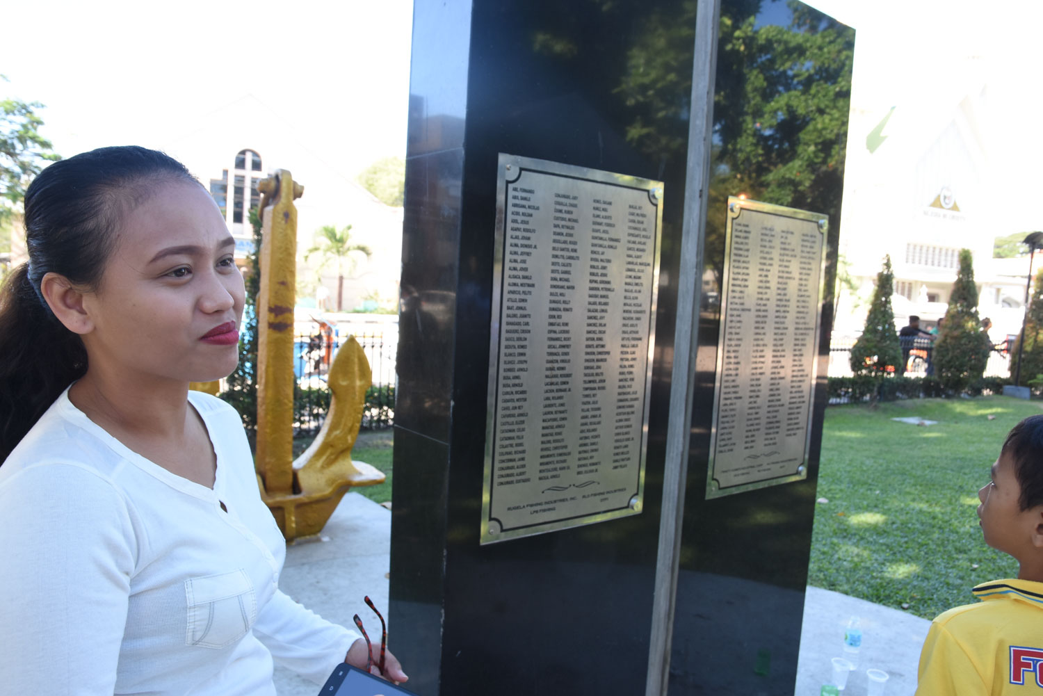 COMMON SITE. Marichu Lamanilao  welcomes the memorial for lives lost due to Pablo, among them, her father.