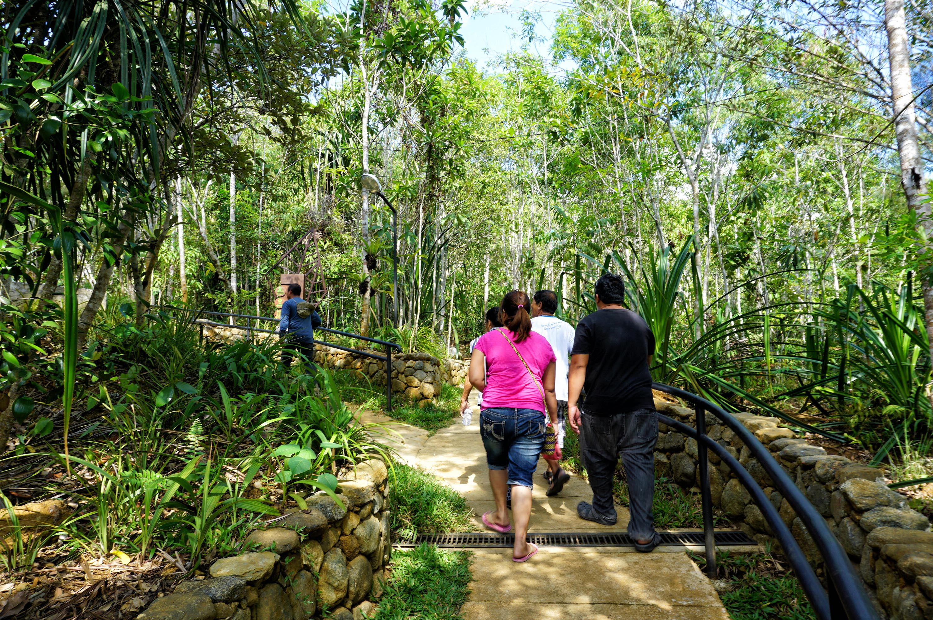 Guests make their way up to the museum. Aside from the museum itself, there are also established trails within the complex. Photo by Louie Lapat
