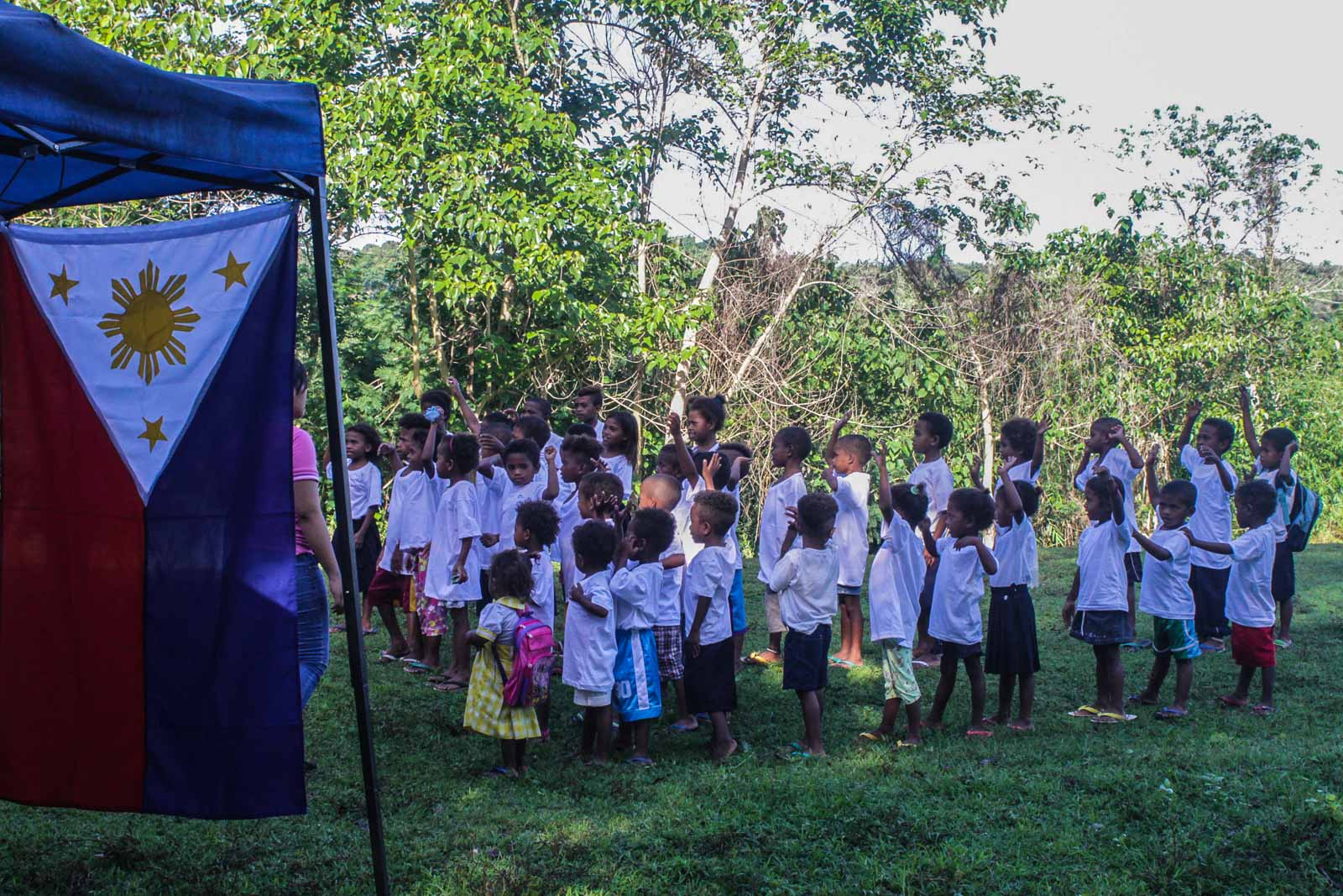 FLAG CEREMONY. Aeta students of the Diaz Elementary School in Porac, Pampanga will be spending their classes in tents after their regular classrooms were destroyed by an earthquake last April. Photo by Lito Borras/Rappler