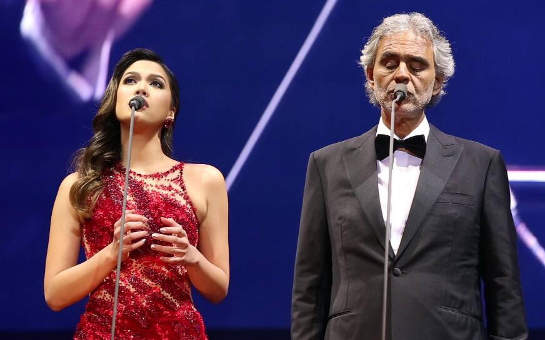 DUET. Christine Allado sings with Andrea Bocelli in Manila. Photo by Roberto Vivancos Studios