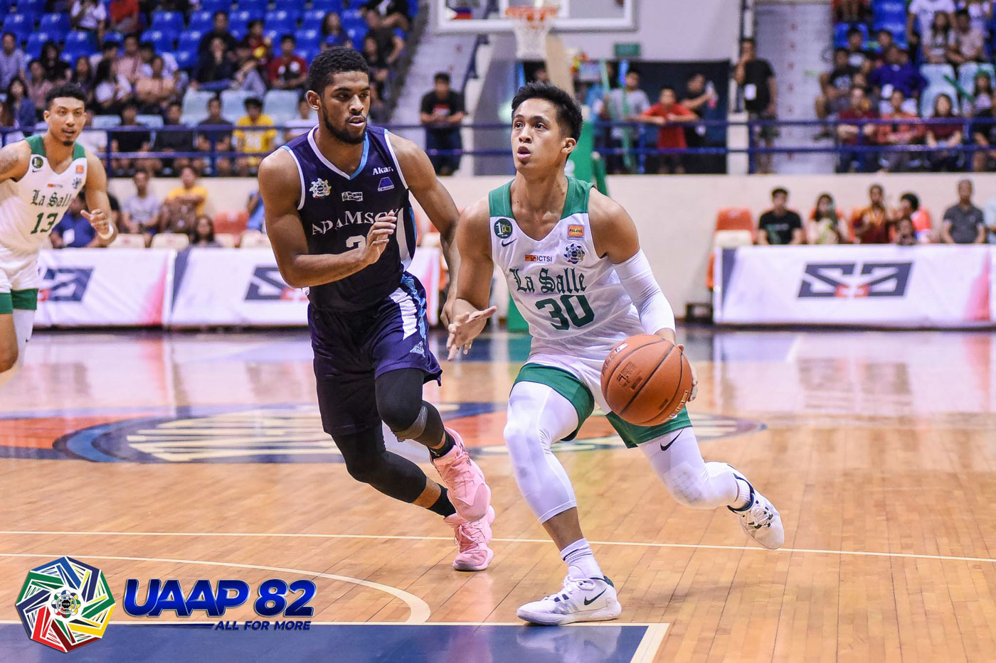 CLUTCH. Andre Caracut's back-to-back triples in the last 58 seconds lift the Green Archers past Jerrick Ahanmisi and the Falcons. Photo release