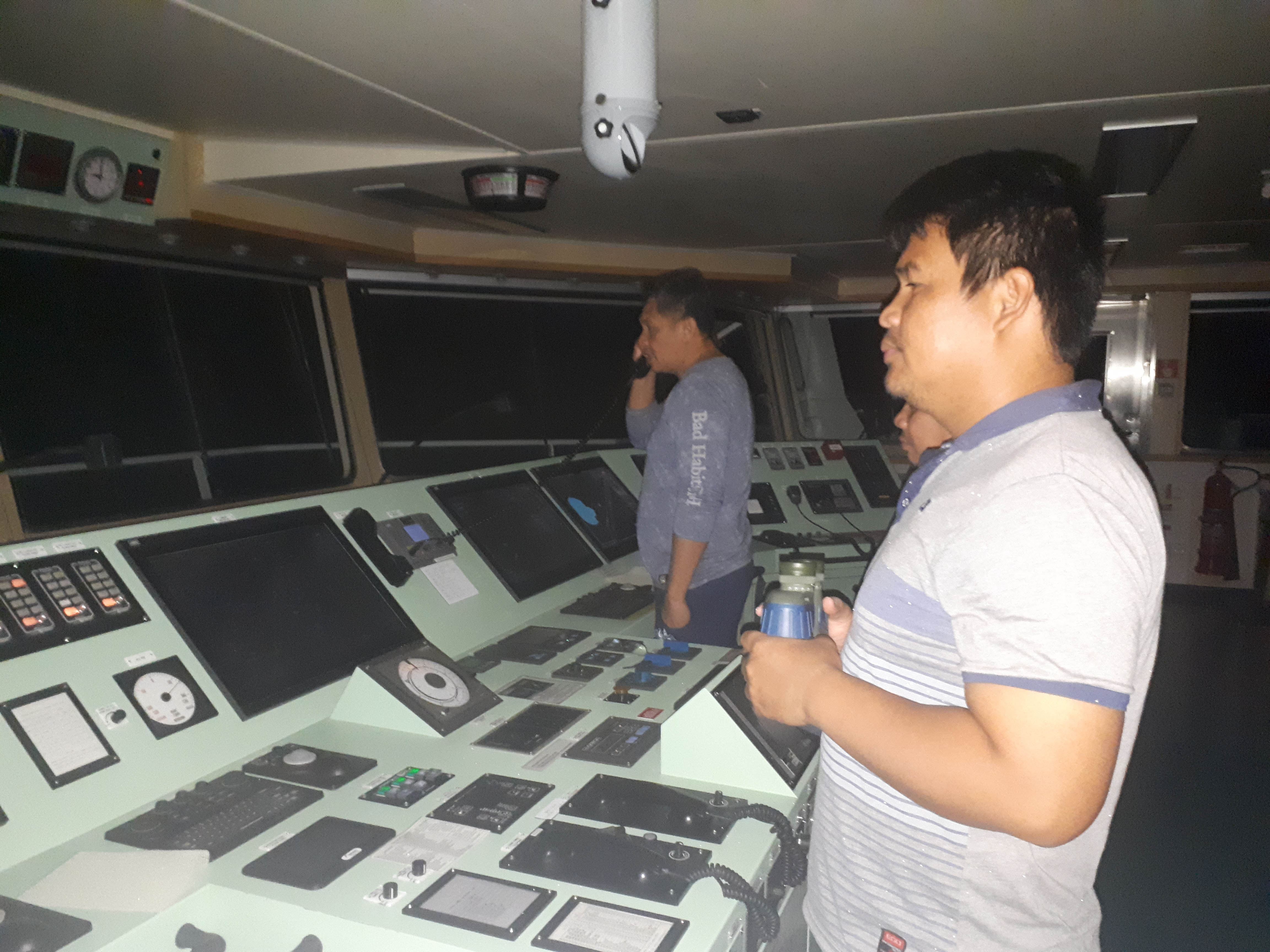 FILIPINO CREW. Ship captain Manolo Ebora (left) speaks to the crew of a 'Chinese warship' on the radio as his crew of fellow Filipinos steer the international oil tanker Green Aura near Scarborough Shoal in the West Philippine Sea on September 30, 2019. Photo courtesy of Captain Manolo Ebora