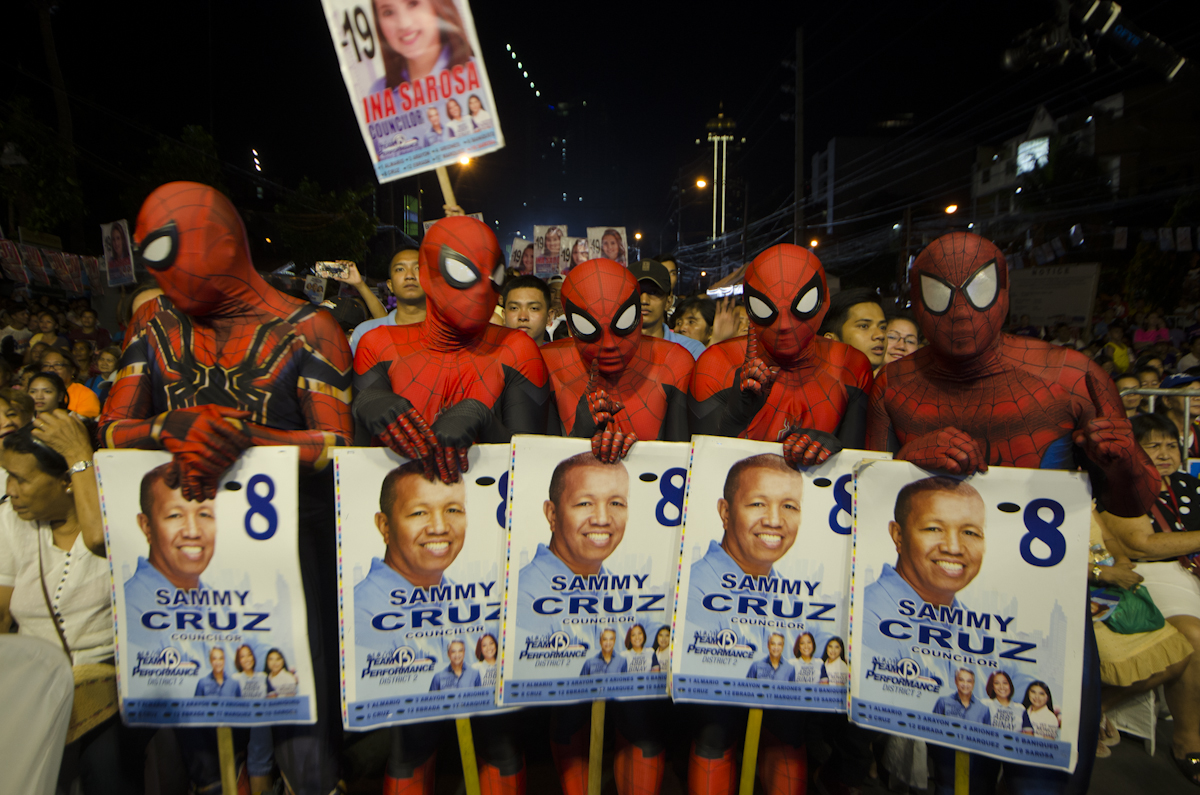 AVID FANS. Supporters of Abby Binay's city council bet Sammy Cruz are dressed like Spiderman. Photo by Rob Reyes/Rappler