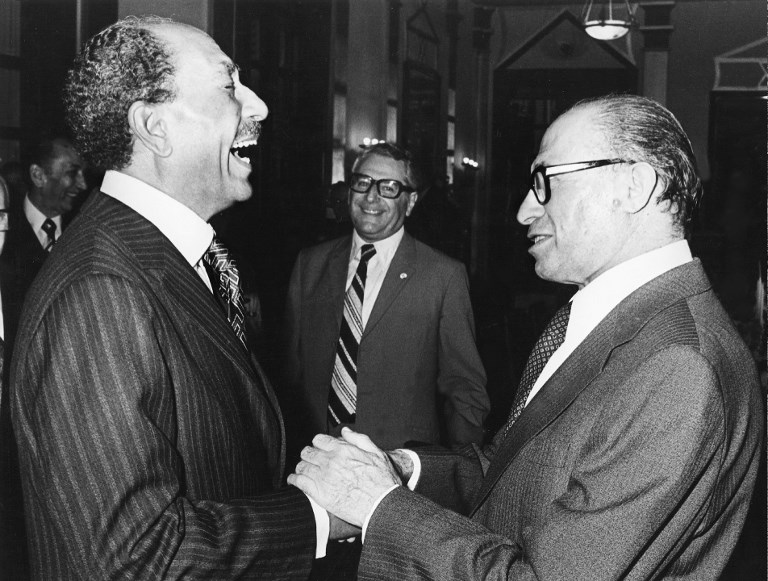 TURNING POINT. In this file photo, Israeli Premier Menahem Begin (r) and Egyptian President Anwar al-Sadate shake hands and joke 20 November 1977 in Jerusalem during Egypt's President historic visit to Israel. N/B B/W / AFP PHOTO / FILES-IPPA