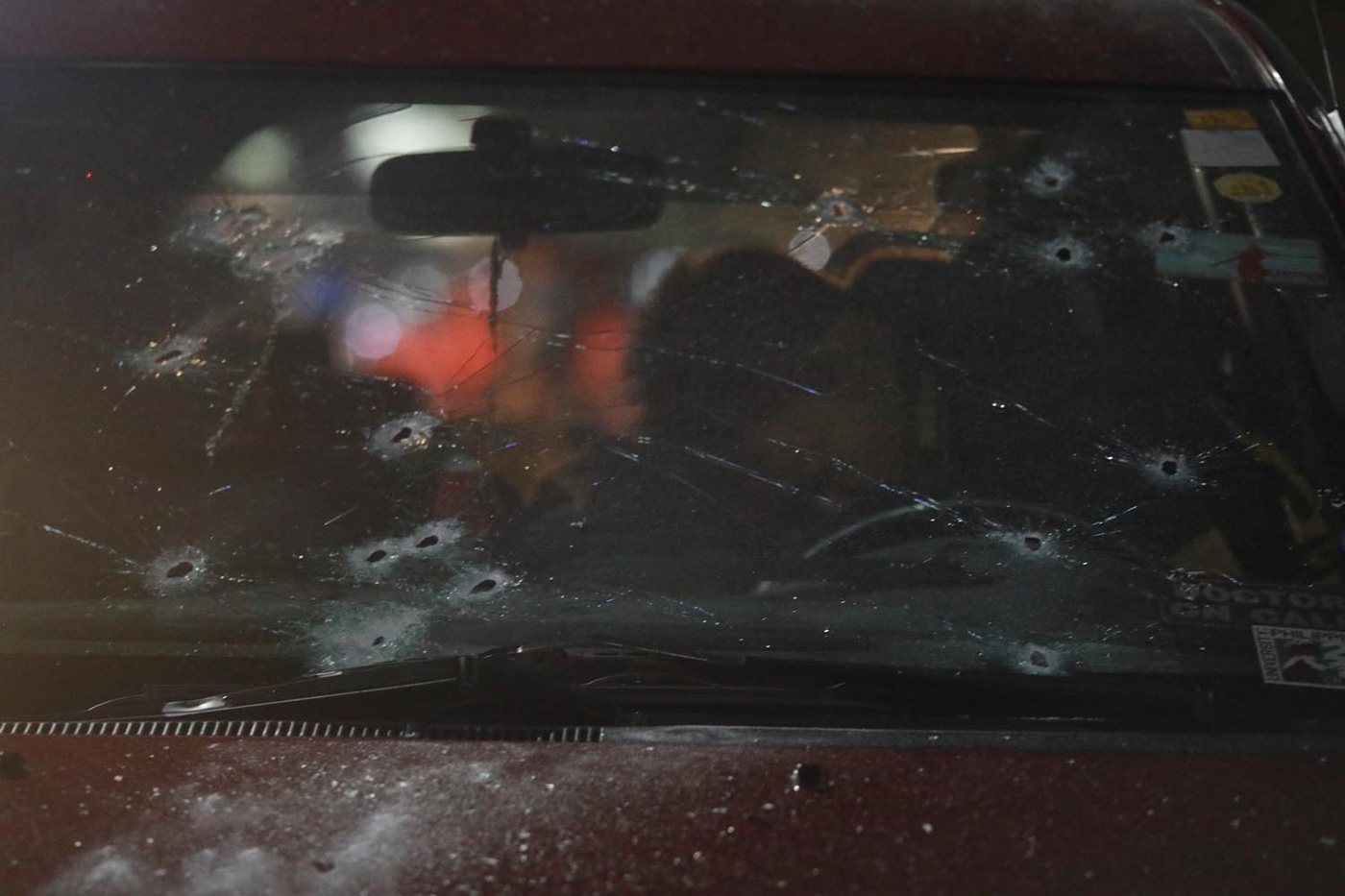 Scene of the Crime Operatives (SOCO) inspect a bullet riddled Toyota Innova at Don Antonio Heights in Quezon City on Friday, May 11, 2018. Quezon City Assitant City Prosecutor Rogelio Velasco was shoot driving his car by unidentified gun men and was rush to a hospital and declared dead on arrival. Photo by DARREN LANGIT