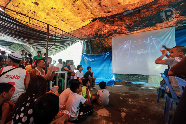 Pacquiao fans in Baguio City watch the live boxing match between #MayPac in a makeshift restobar set up by an enterprising businessman in a rooftop laundry area. Photo by Dave Leprozo/Rappler