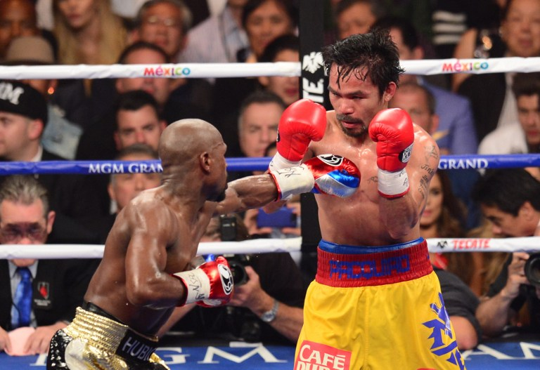 Floyd Mayweather Jr., and Manny Pacquiao fight in a welterweight unification bout on May 2, 2015 at the MGM Grand Garden Arena in Las Vegas, Nevada. Frederic J. Brown/AFP