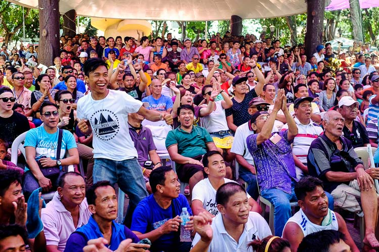 Crowd reacts as they watched Manny Paquiao connects his punches against Floyd Mayweather at the Misamis Oriental Capitol Ground In Cagayan de Oro City. Photo by Bobby Lagsa/Rappler