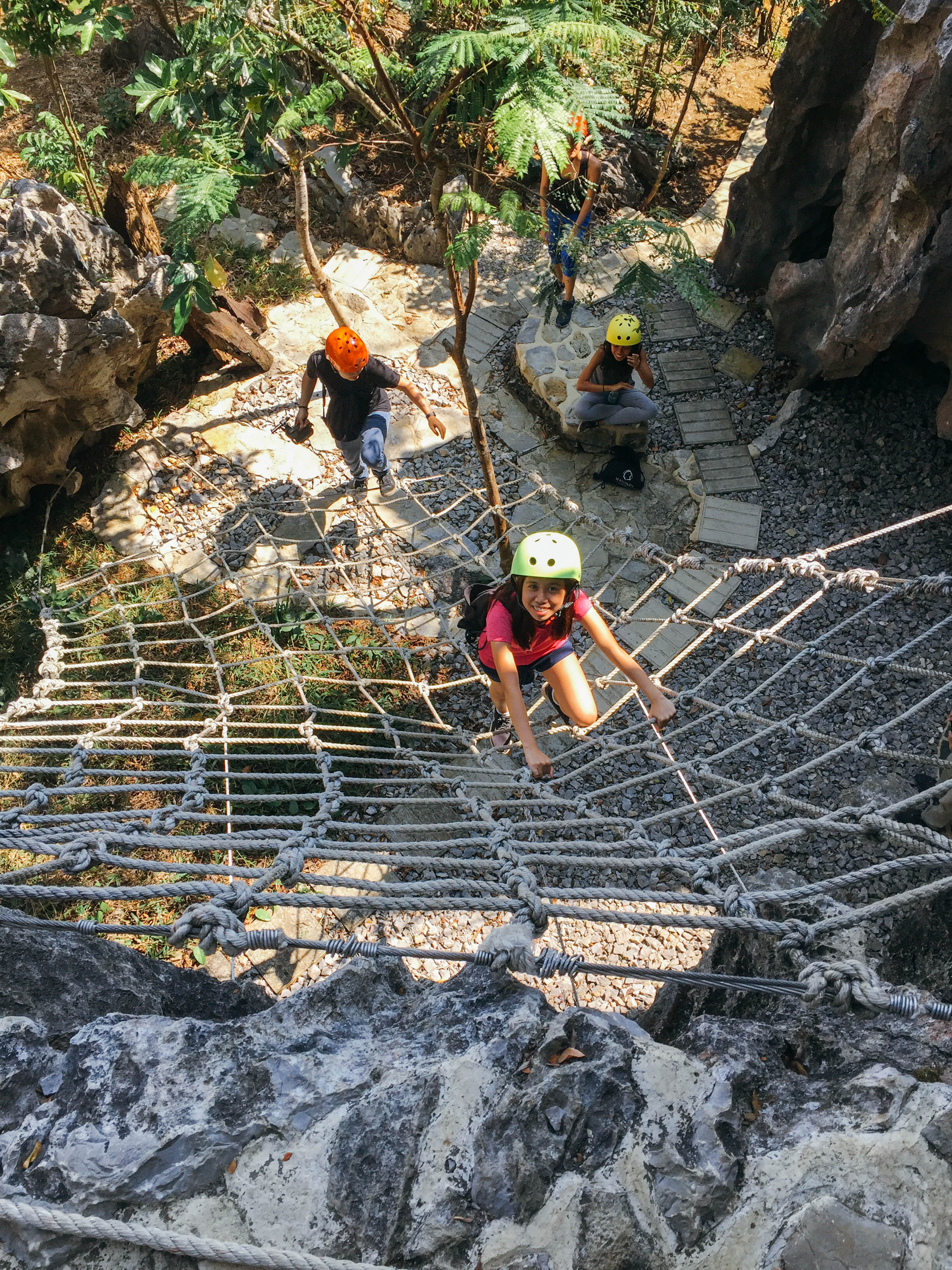 LAMBAT. The first rope course that visiting groups will encounter in Masungi is a rope net that allows them to climb a rock wall and onto the rest of the conservation. Photo by Nicole Reyes/Rappler