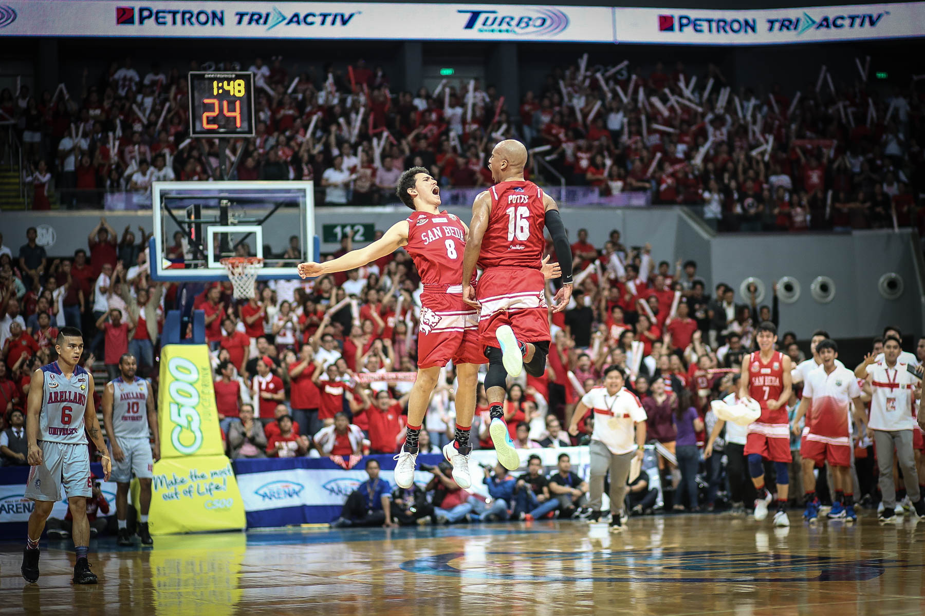 THRILL. Robert Bolick and Davon Potts revel in the thrill of the NCAA Finals. Photo by Josh Albelda/Rappler