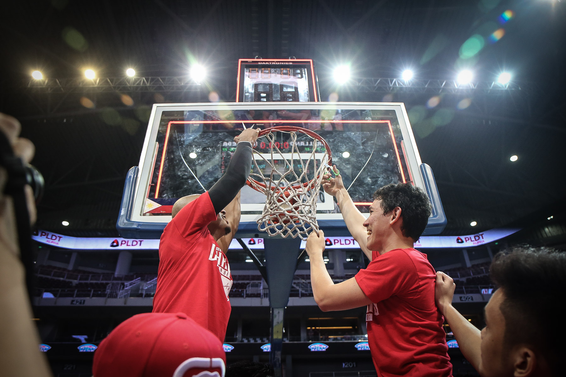 TAKE IT HOME. San Beda players cut down the championship net. Photo by Josh Albelda/Rappler