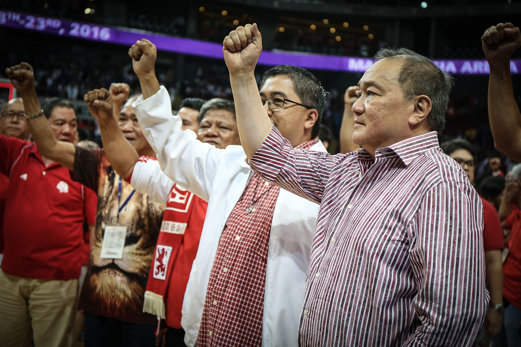 MVP. San Beda basketball patron Manny V. Pangilinan sings the hymn and celebrates with the Red Lions on the court. Photo by Josh Albelda/Rappler