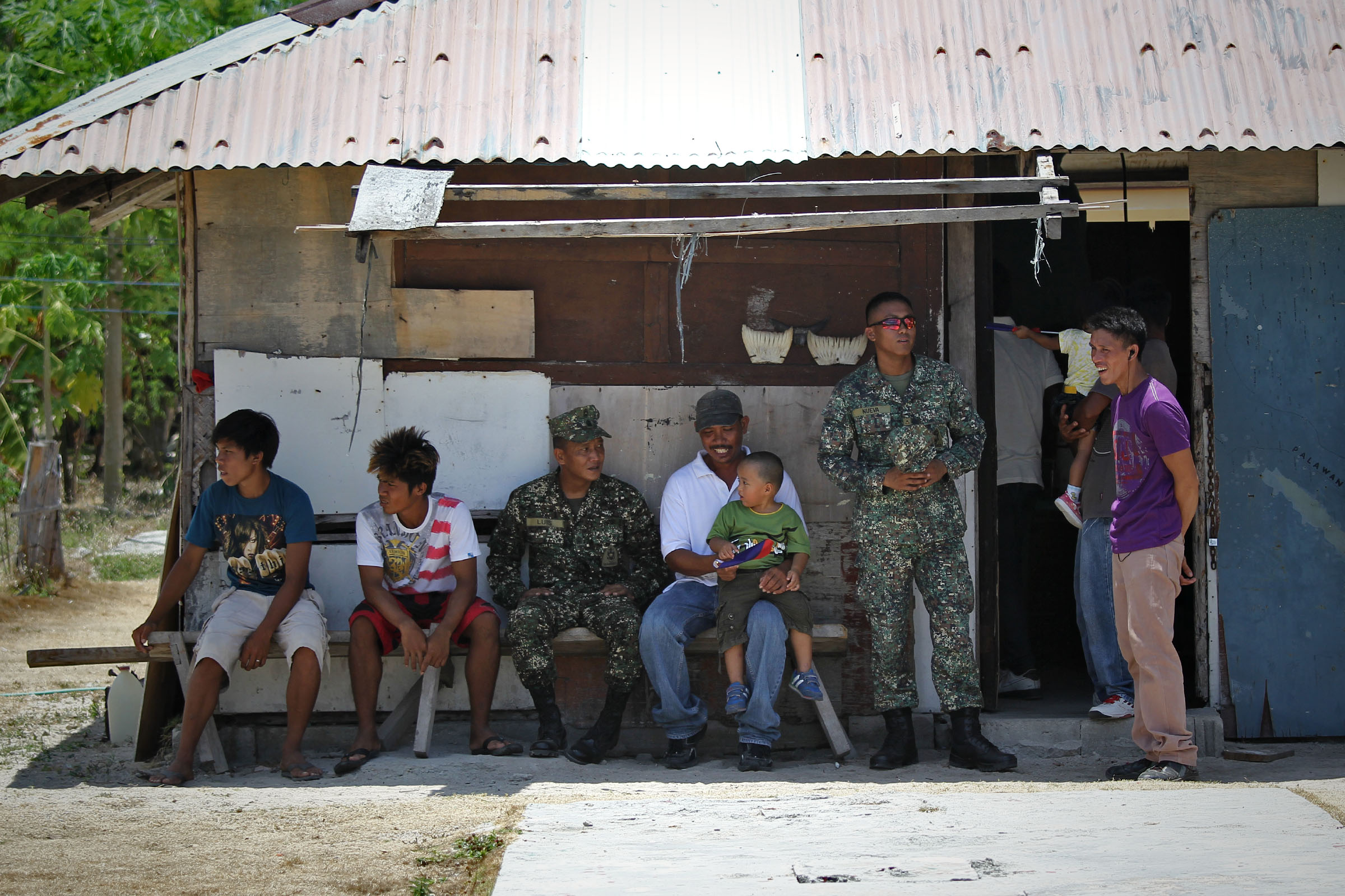 JUST ANOTHER DAY. Soldiers and civilians on Pag-asa Island. Photo by Vincent Go/Rappler