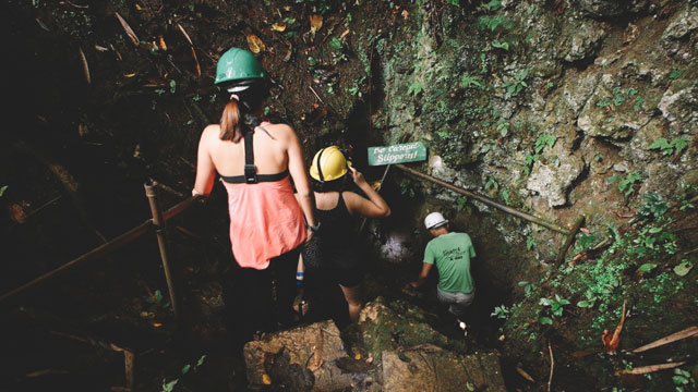 TRY SPELUNKING THIS YEAR. Cantabon Cave in Siquijor has 800 meters of vertical climbs, icy water, and sparkling white limestone formations