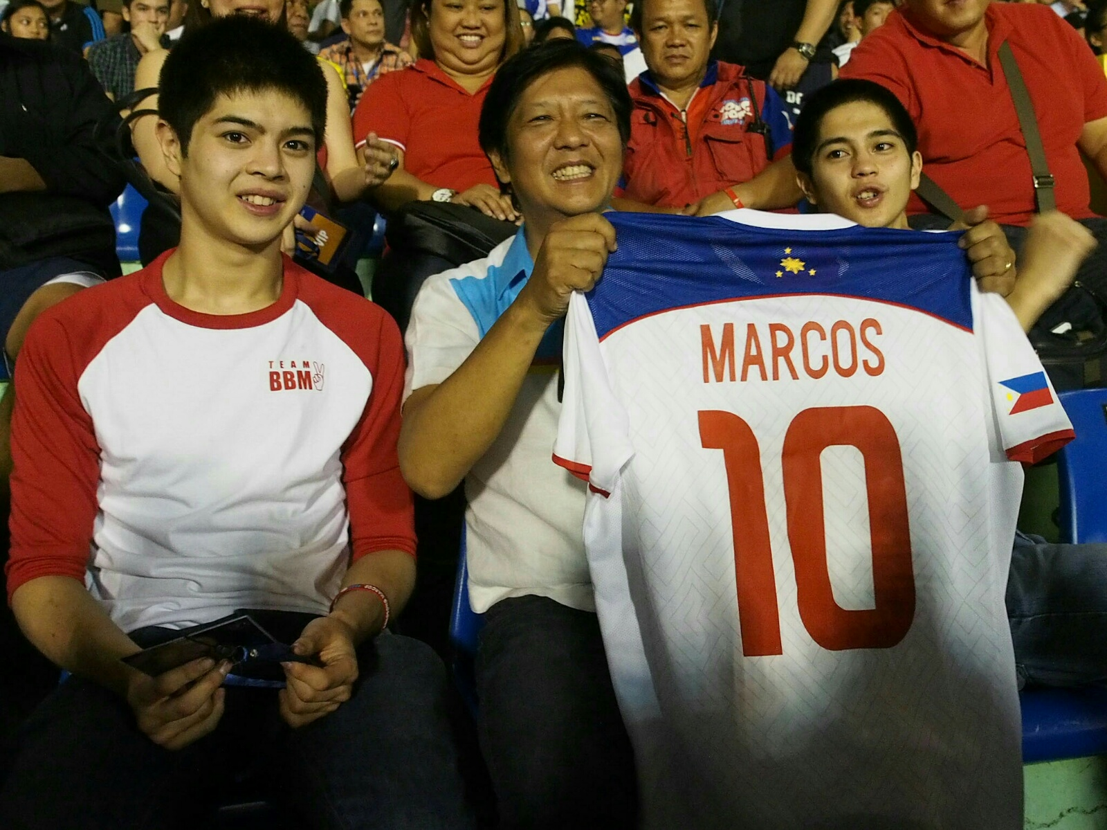 FAMILY TIME. Bongbong Marcos watches Tuesday evening's game with his two sons. Photo from the Office of Senator Bongbong Marcos