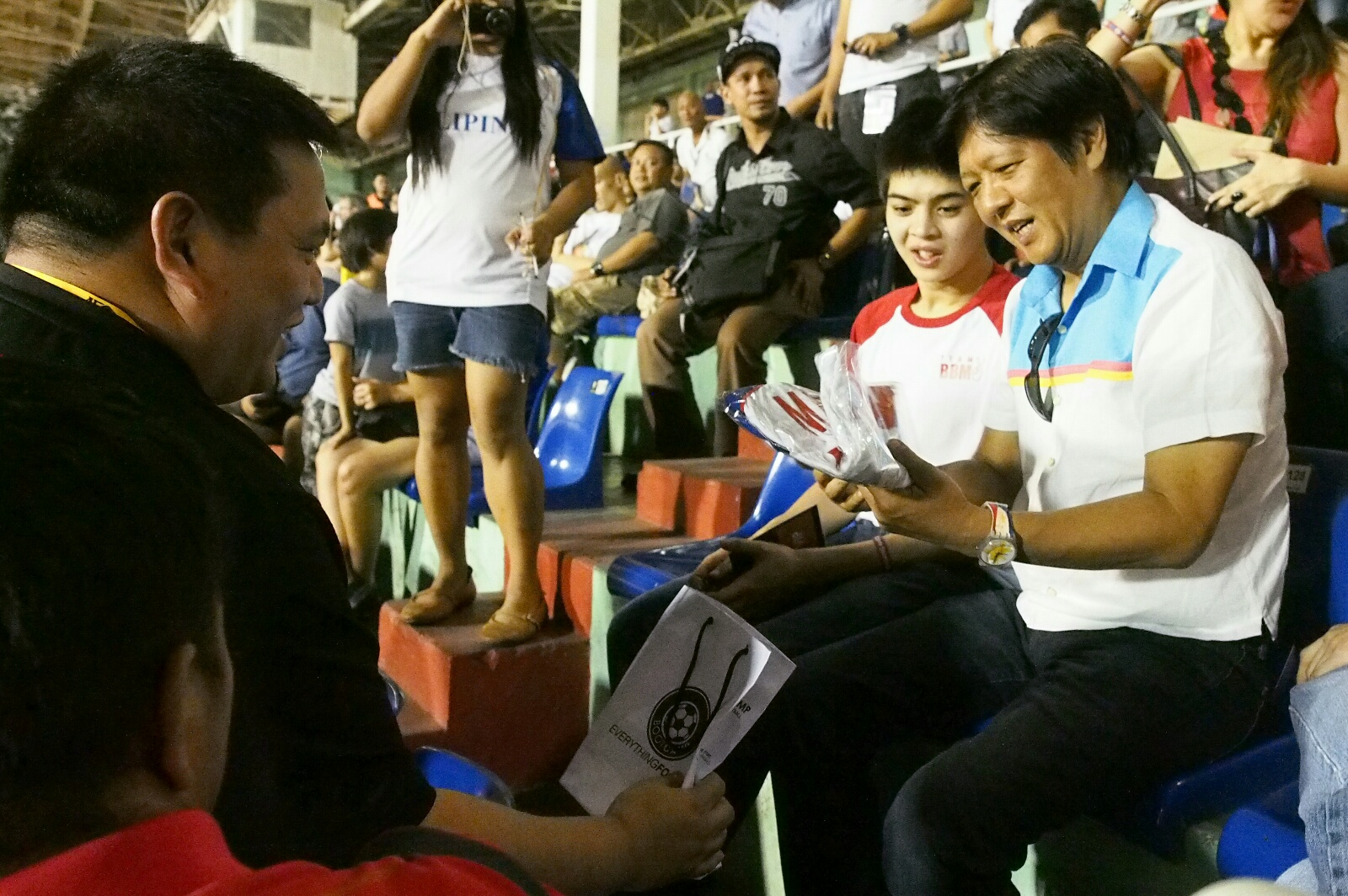 AZKALS' NO. 10. Vice presidential candidate Senator Ferdinand 'Bongbong' Marcos Jr receives the No. 10 Azkals jersey from team manager Dan Palami during Tuesday night's game between the Philippines and North Korea. Photo from the Office of Senator Bongbong Marcos