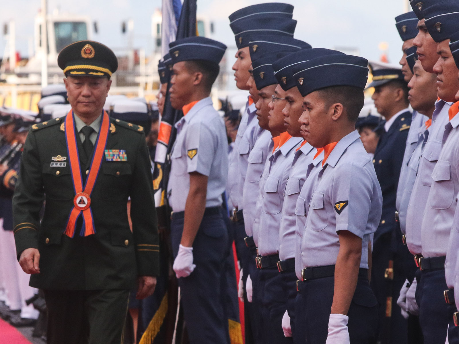 WELCOMED. China Coast Guard Major General Wang Zhongcai during the arrival honors at Philippine Coast Guard Headquarters in Manila on January 14, 2020. Photo by KD Madrilejos/Rappler