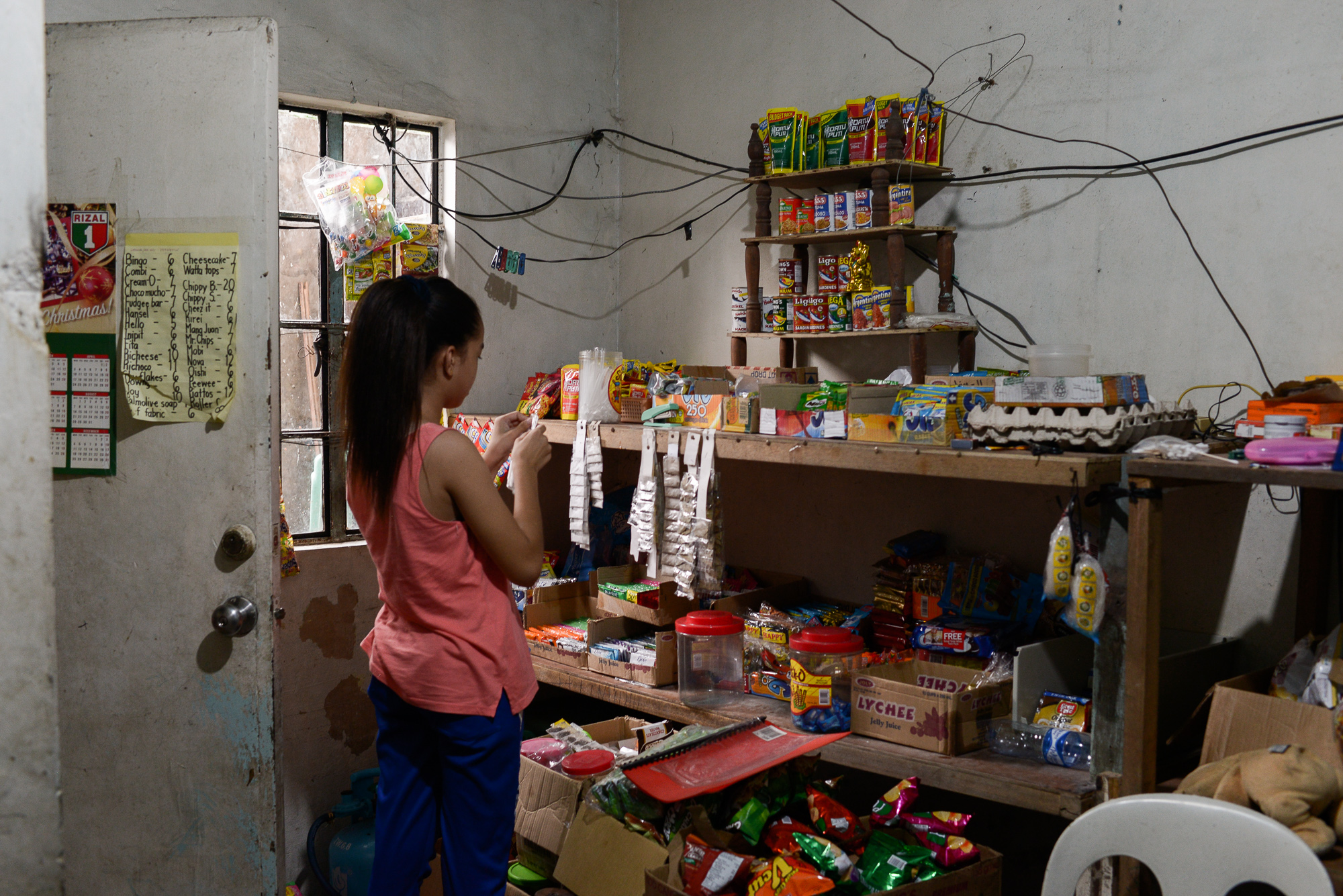 STORE. Carl's niece now mans his sari-sari store at home. Photo by Eloisa Lopez/Rappler