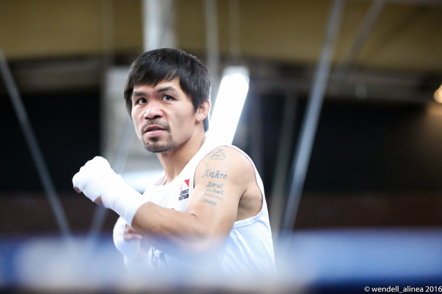 ON HIS TERMS. 'I love this sport and until the passion is gone, I will continue to fight for God, my family, my fans and my country,' says Manny Pacquiao. File photo by Wendell Alinea