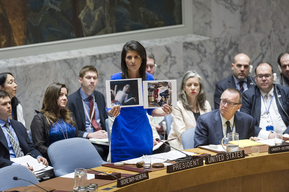 COUNCIL MEETING. Nikki Haley (center), United States Permanent Representative to the UN and President of the Security Council for April, addresses the meeting of the council on the alleged use of chemical weapons in an April 4 airstrike in Idlib, Syria, April 5, 2017. Phot by Rick Bajornas/UN Photo