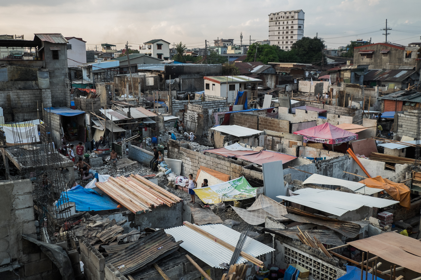 NEW YEAR TRAGEDY. Some homes have already been rebuilt two weeks after the fire that razed at least 1,000 homes in Dagupan Extension, Tondo, Manila. All photos by Pat Nabong/Rappler