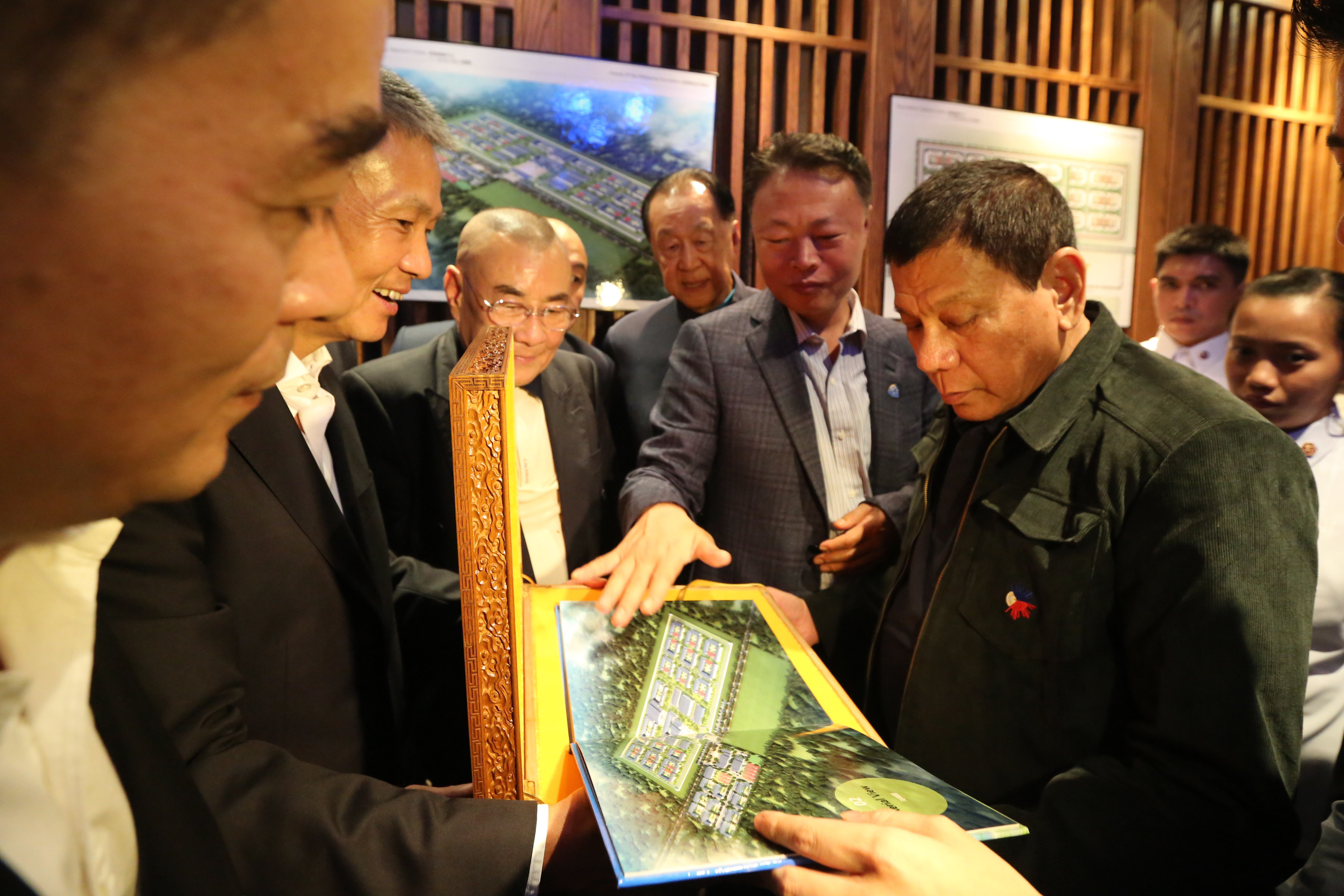 GIFT FROM FRIENDS. President Rodrigo Duterte receives the architect's perspective and blueprint of the proposed Drug Addiction Treatment Center to be donated by the Friends of the Philippines Foundation during a lunch meeting at Dadong Roast Duck Restaurant in Beijing, China on October 19, 2016. Photo by King Rodriguez/Presidential Photo