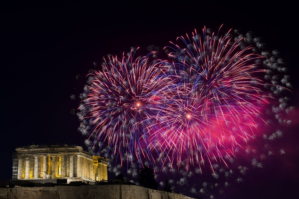 PARTHENON. Fireworks explode over the ancient temple of the Parthenon on top of the Acropolis hill as part of Greece's celebrations for the New Year in Athens on January 1, 2020. Photo by Aris Messinis/AFP