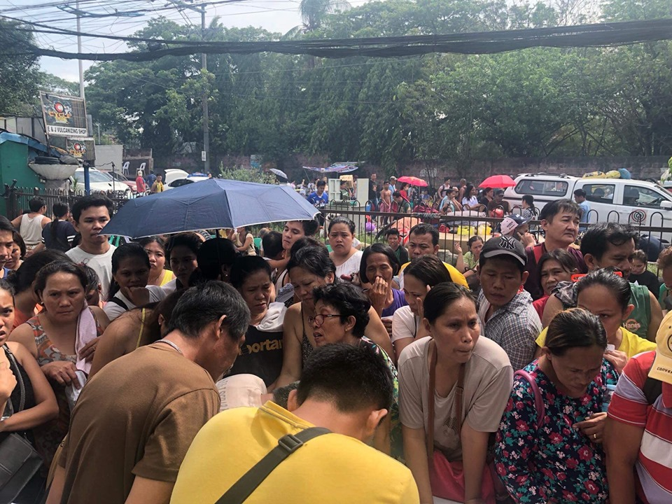 DISPLACED. Residents gather on the roadside as firemen put out te blaze in their community on June 27, 2019. Photo from Mandaue City PIO Facebook page