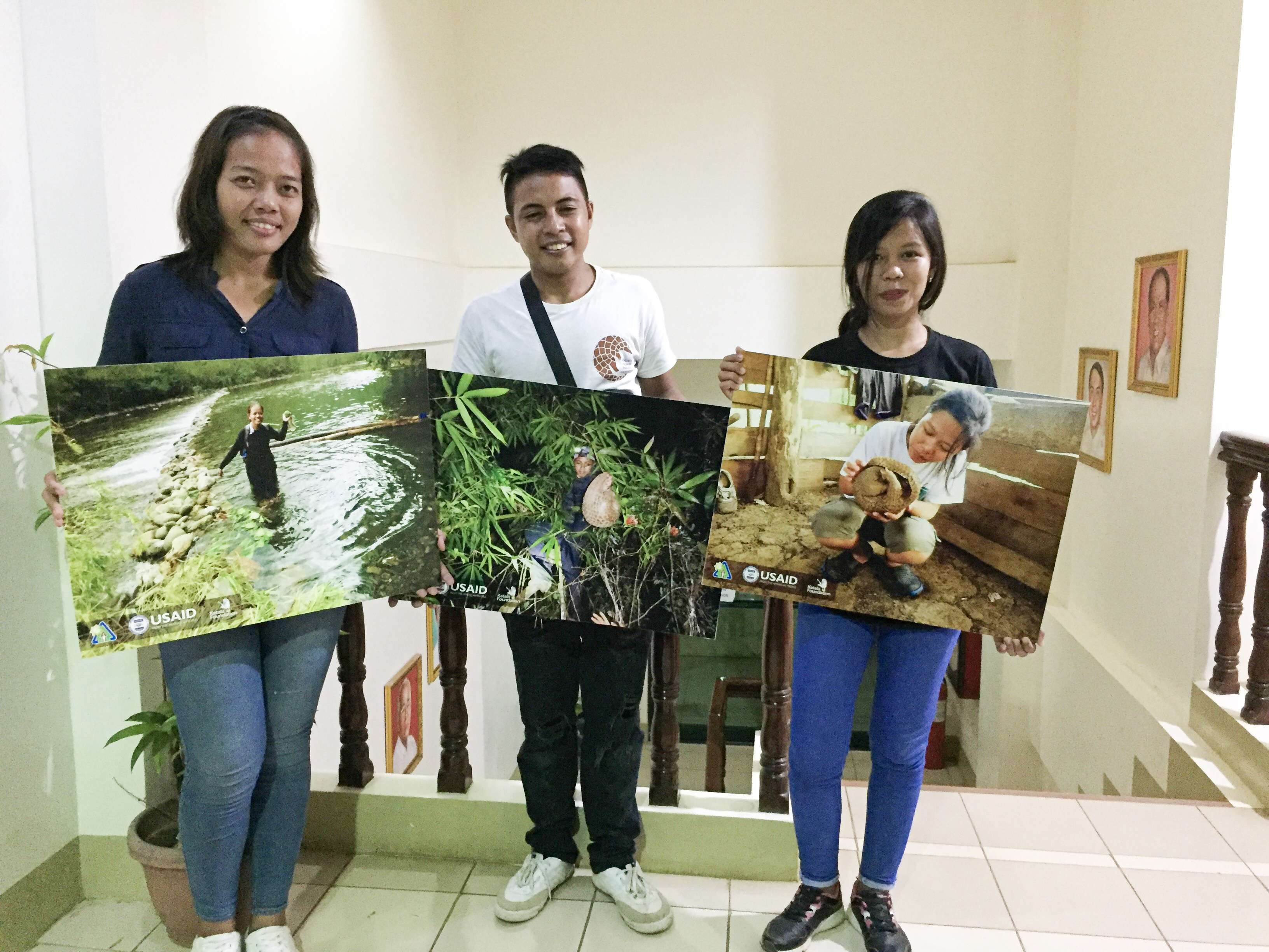 HOPEFUL. Palawan Pangolin Conservation Program research assistants proudly show their enlarged photos taken in the Victoria-Anepahan Mountain Range, one of the known pangolin habitats in the province. Photo by Keith Anthony S. Fabro