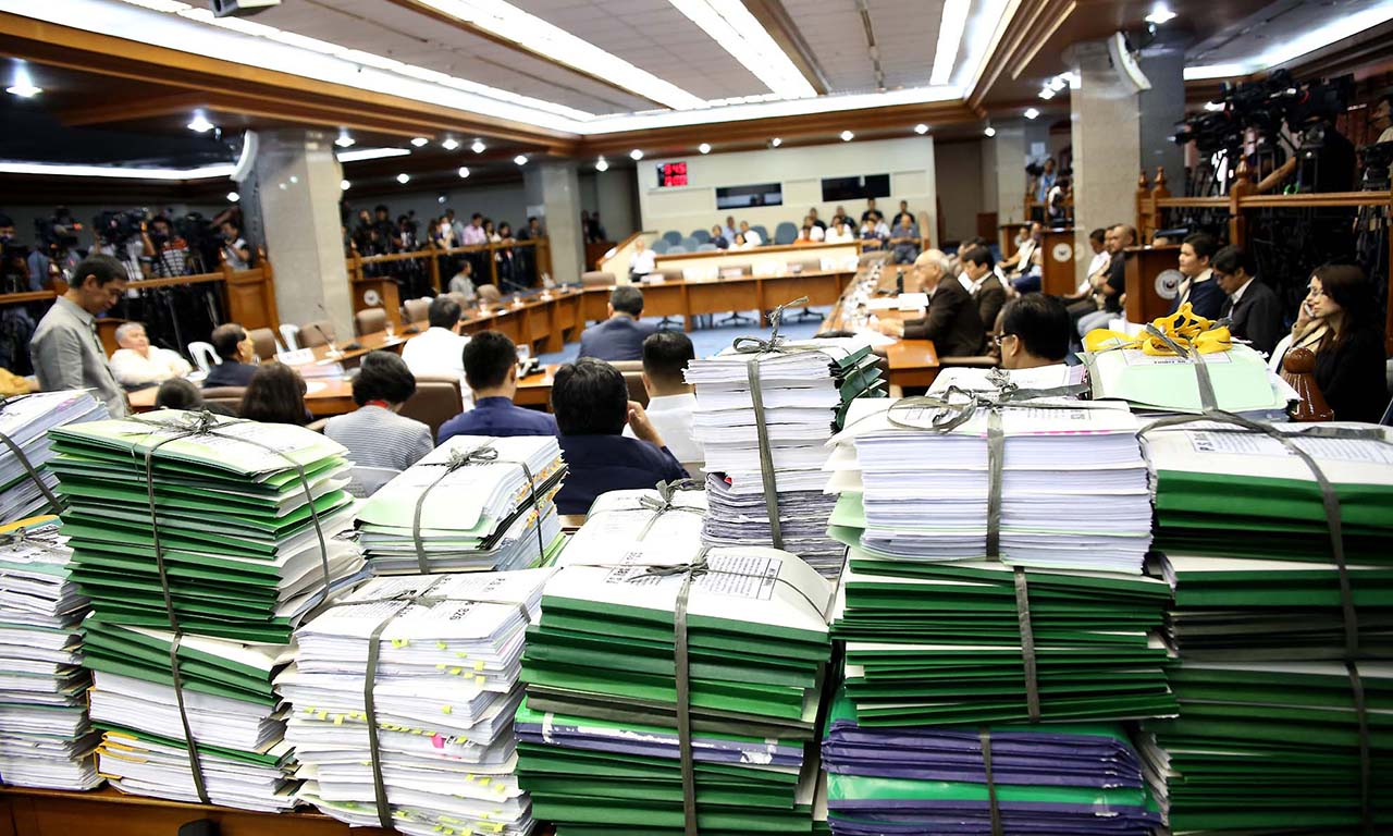 EVIDENCE AGAINST THE VICE PRESIDENT. The folders of evidence Trillanes referred during the January 26 Senate hearing. Photo by Alex Nuevaespau00f1a/Senate PRIB