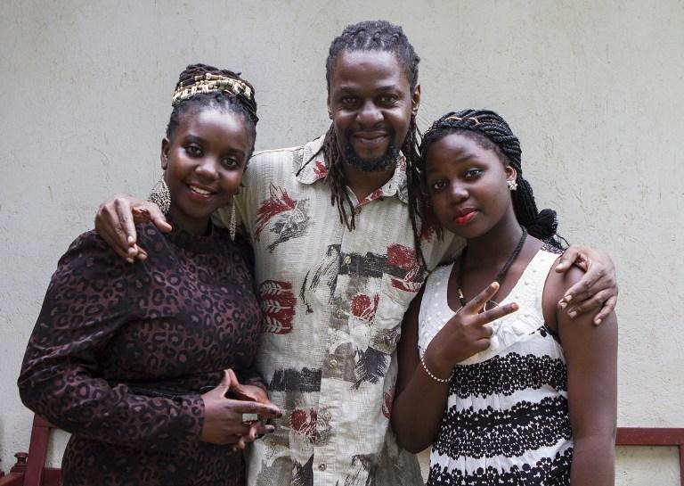 NEWS CREW. A picture taken on April 17, 2015 shows Newzbeat's host Sharon Bwogi AKA Lady Slyke (L), writer and producter Daniel Kisekka aka 'Survivor (C) and rapper Zoe Kabuye aka 'MC Loy' posing at the company's office in Kampala. Isaac Kasamani/AFP