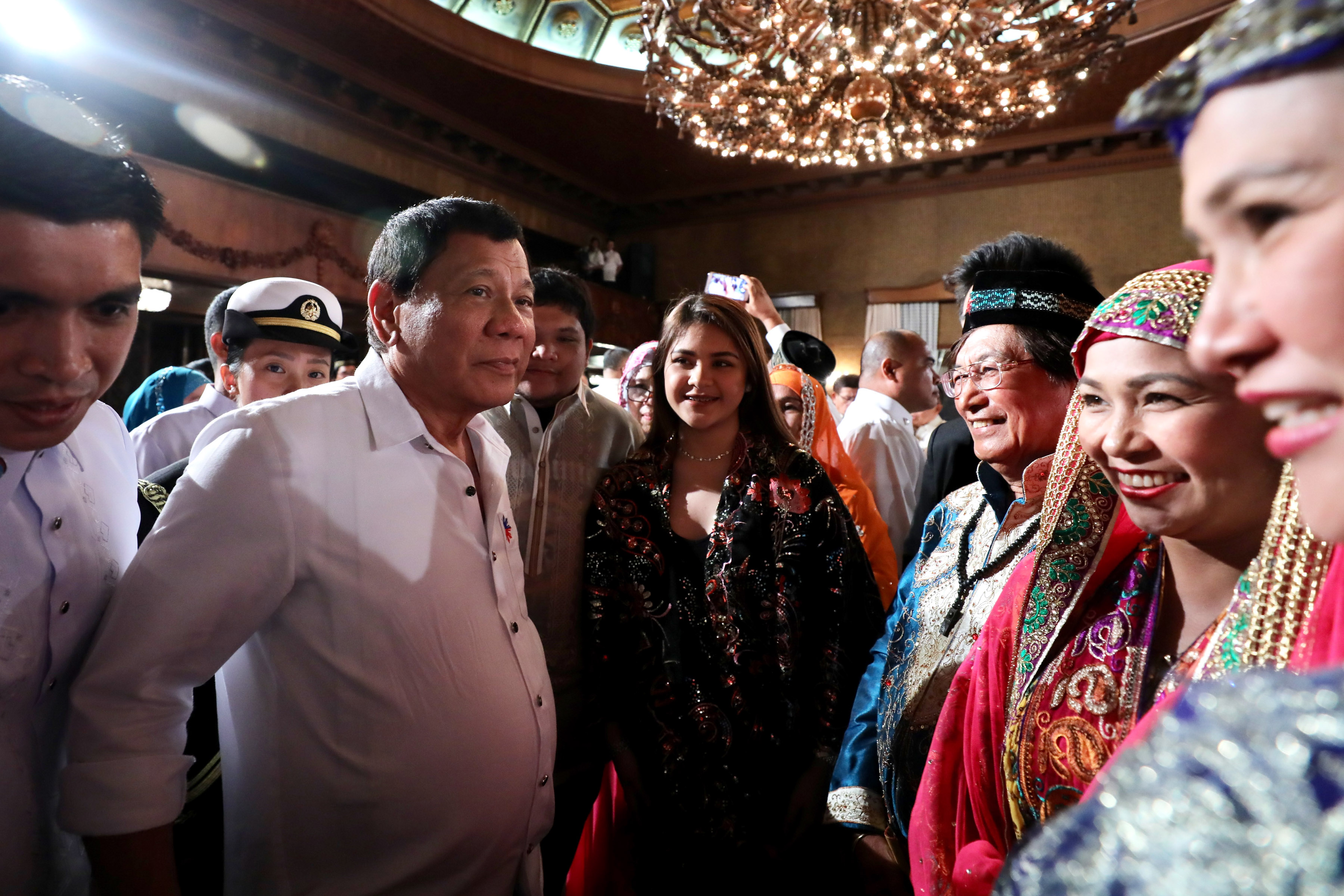 PALACE GUEST. President Duterte's grandchildren Isabelle (middle) and Omar attend the Eid'l Fitr celebration in Malacau00f1ang with their mother Lovelie Sangkola Sumera (foreground, in blue). Presidential photo