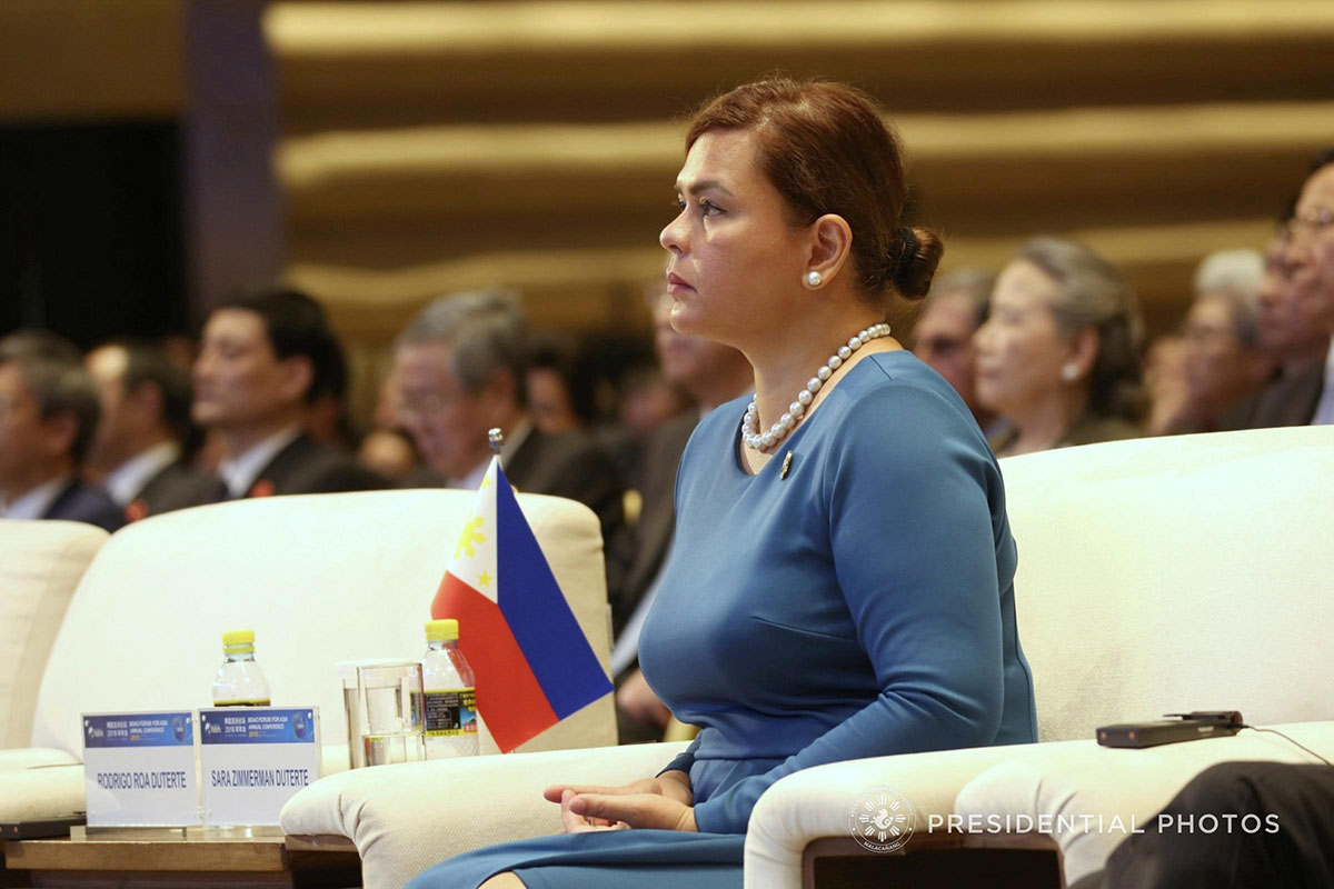 DAVAO MAYOR. Davao City Mayor Sara Duterte-Carpio listens as her father President Rodrigo Roa Duterte delivers his speech during the opening ceremony of Boao Forum for Asia (BFA) Annual Conference 2018 in China on April 10, 2018. Malacau00f1ang file photo