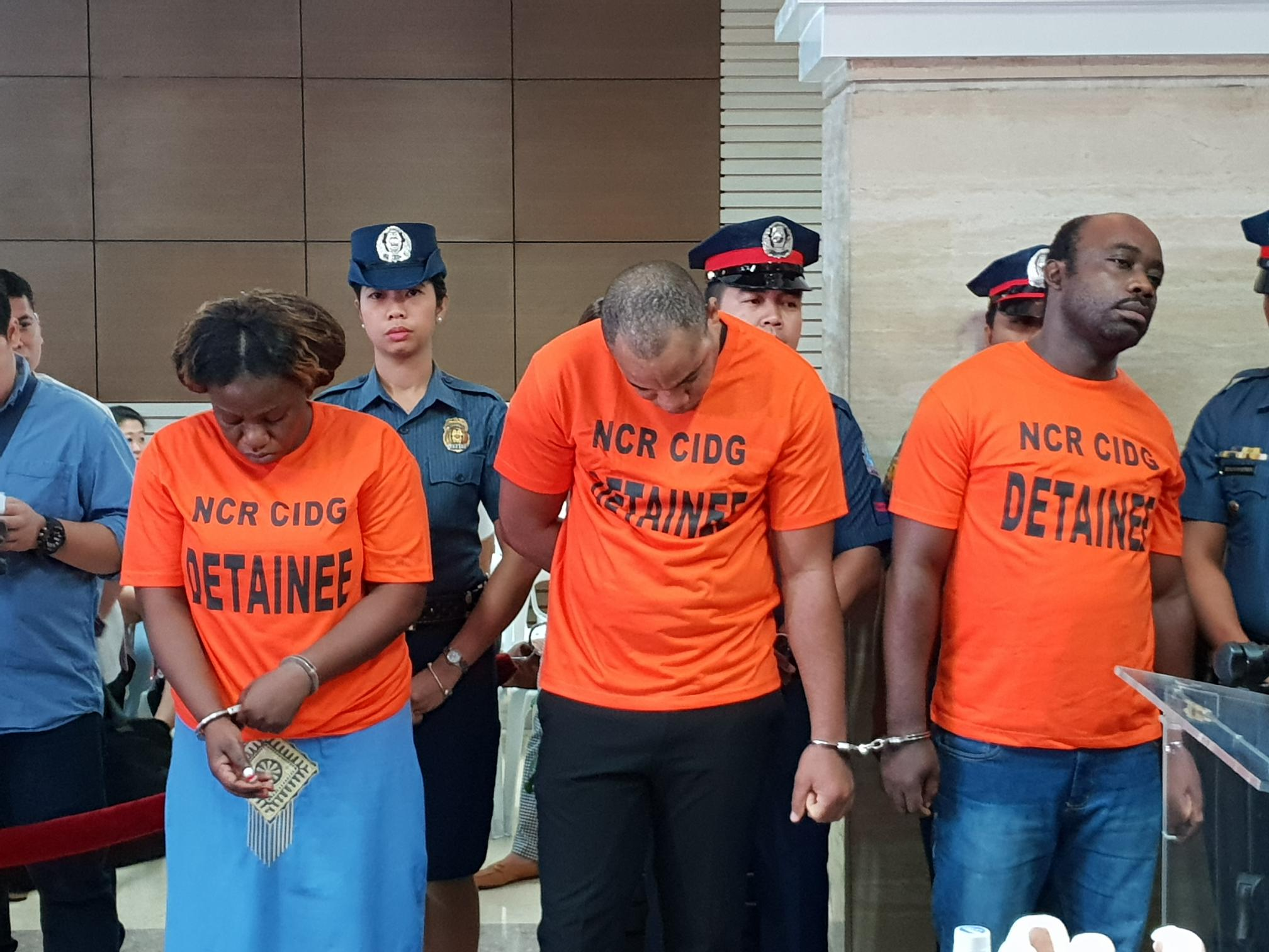 ARRESTED. The supposed members of an Angolan Budol-budol gang are presented in Camp Crame. Photo by Rambo Talabong/Rappler
