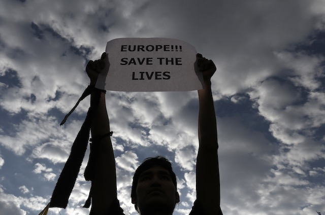 'SAVE THE LIVES' An immigrant living in Greece takes part in a protest against the deaths of migrants in the Mediterranean, outside the European Union office in central Athens, Greece, April 22, 2015. Yannis Kolesidis/EPA