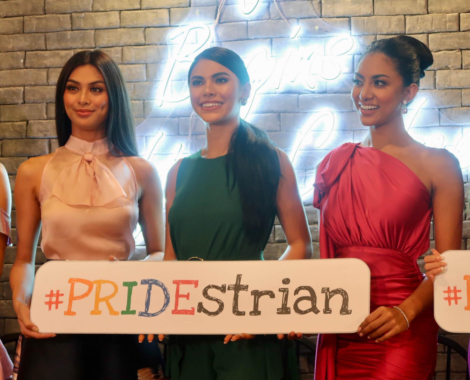 PRIDESTRIAN. Bb. Pilipinas International 2019 Patch Magtanong, Miss Universe Philippines 2019 Gazini Ganados, and Bb Pilipinas Supranational 2019 Resham Saeed hold the 'Pridestrian' sign.