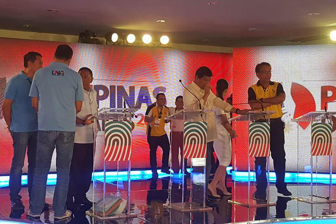 DEBATE BEFORE THE DEBATE. Behind the scenes before the March 20 presidential debate in Cebu City. Photo by Rappler