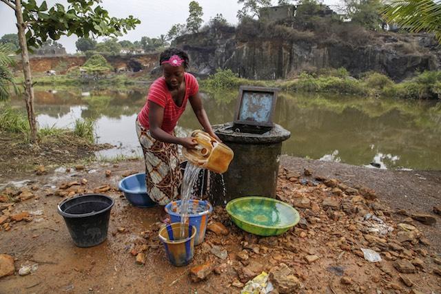 PRECIOUS RESOURCE. A Liberian woman fetching water in Monrovia, Liberia, March 21, 2013. Ahmed Jallanzo/EPA