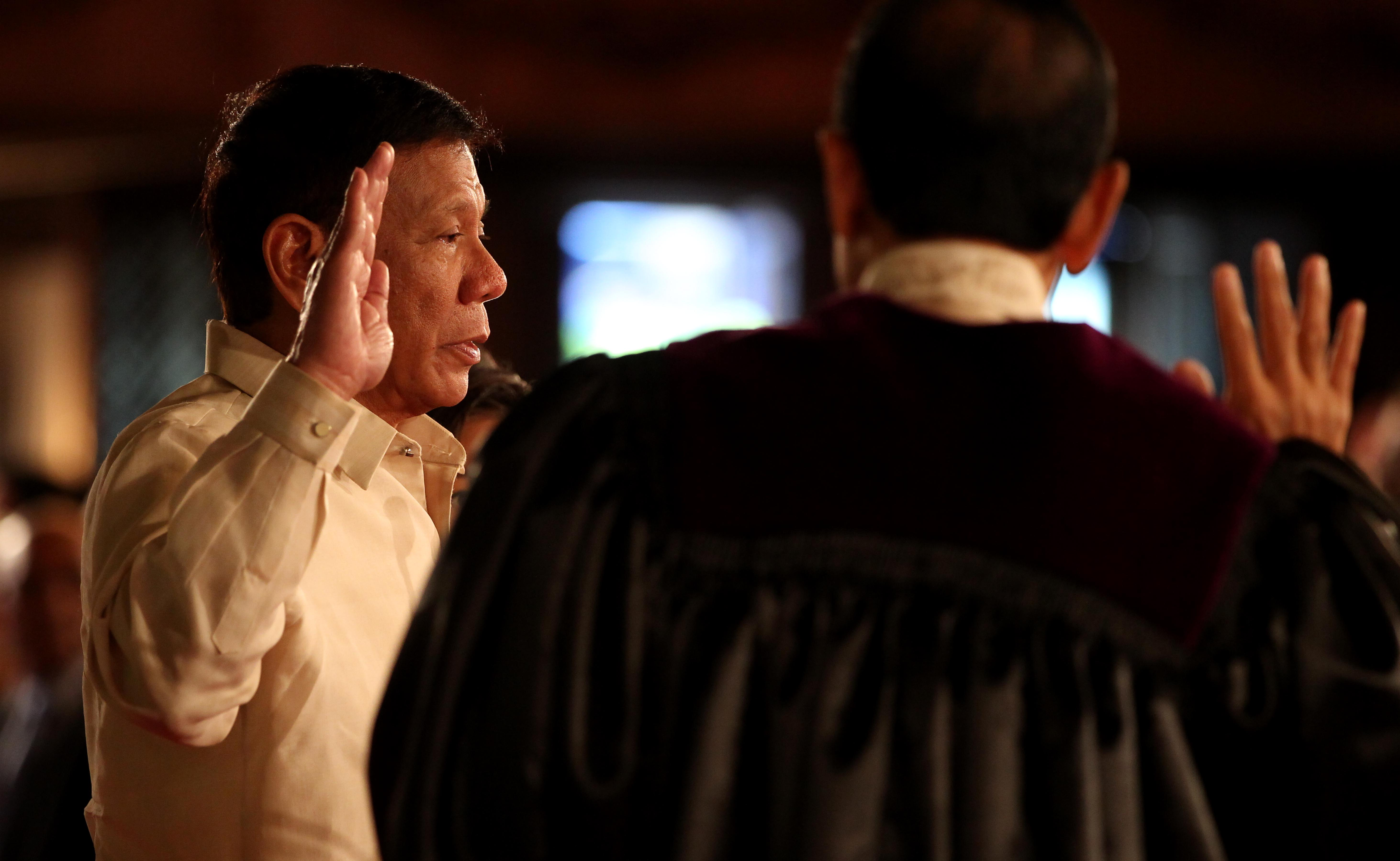 SWORN IN. Rodrigo Duterte takes his oath of office as the 16th President of the Republic of the Philippines on June 30, 2016.