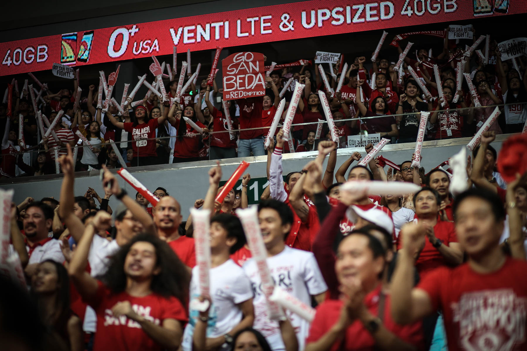 REDEMPTION. San Beda fans cheer their team on as they redeem themselves from a championship loss last season. Photo by Josh Albelda/Rappler