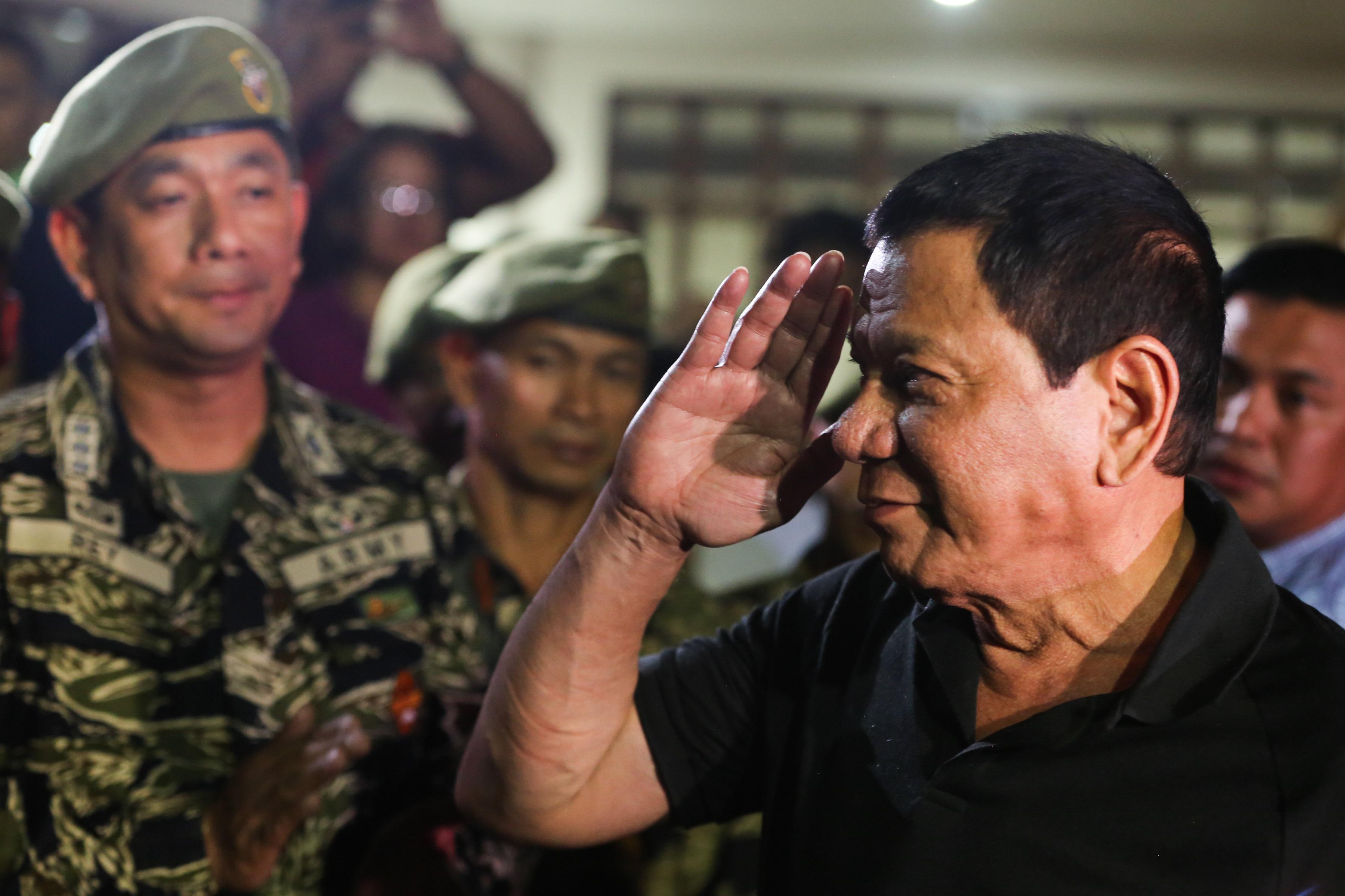 SALUTE. In this file photo, President Duterte visits the wake of slain Captain Clinton Capio at the Libingan ng mga Bayani in Fort Bonifacio on January 16, 2017. File photo courtesy of Malacau00f1ang