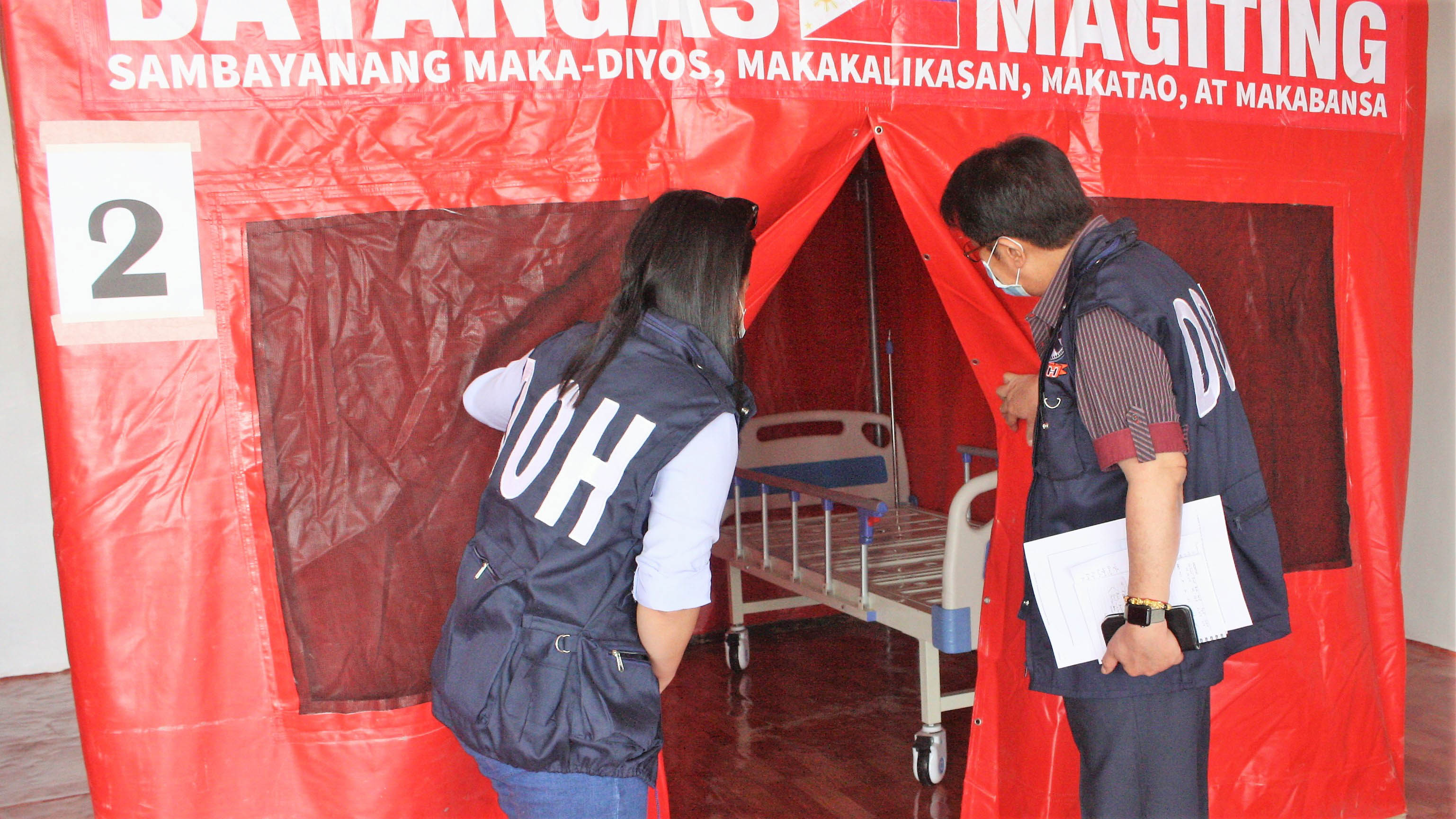 ISOLATION FACILITY. DOH-CALABARZON Regional Director Eduardo C. Janairo (left) inspects the inside of tent which will serve as an isolation unit for persons deprived of liberty who will be tested positive for COVID-19. The Batangas Provincial Isolation Facility is located at Brgy Malainin, Ibaan. Photo from DOH Calabarzon