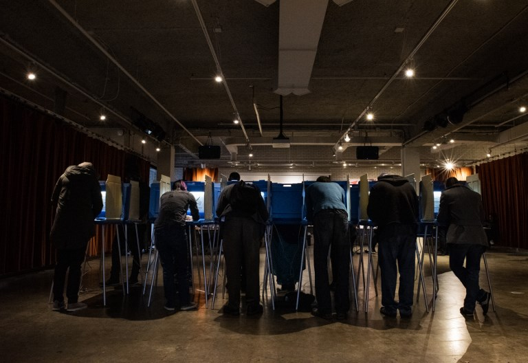US VOTES. Voters fill out their ballots at Minneapolis College of Art and Design on November 6, 2018 in Minneapolis, United States. File photo by Stephen Maturen/Getty Images/AFP