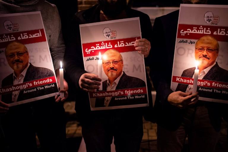 JUSTICE. People hold posters picturing Saudi journalist Jamal Khashoggi and lightened candles during a gathering outside the Saudi Arabia consulate in Istanbu. File photo by Yasin AKGUL / AFP