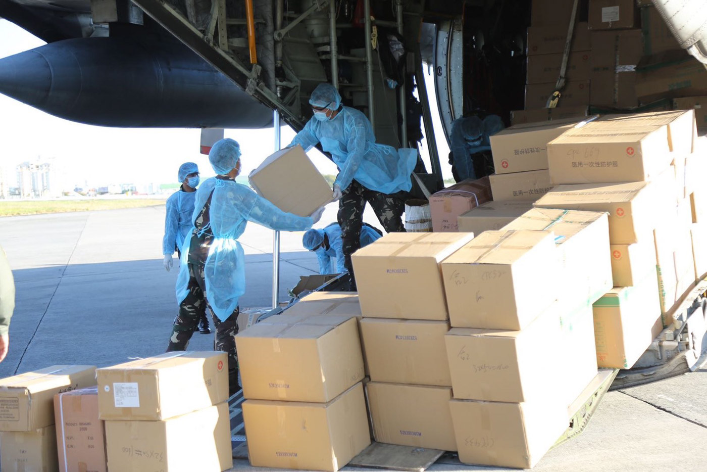 EQUIPMENT, SUPPLIES. Soldiers unload donated cargo from the Philippine Air Force's C-130 plane at Villamor Airbase on March 21, 2020. Photo from the Armed Forces of the Philippines