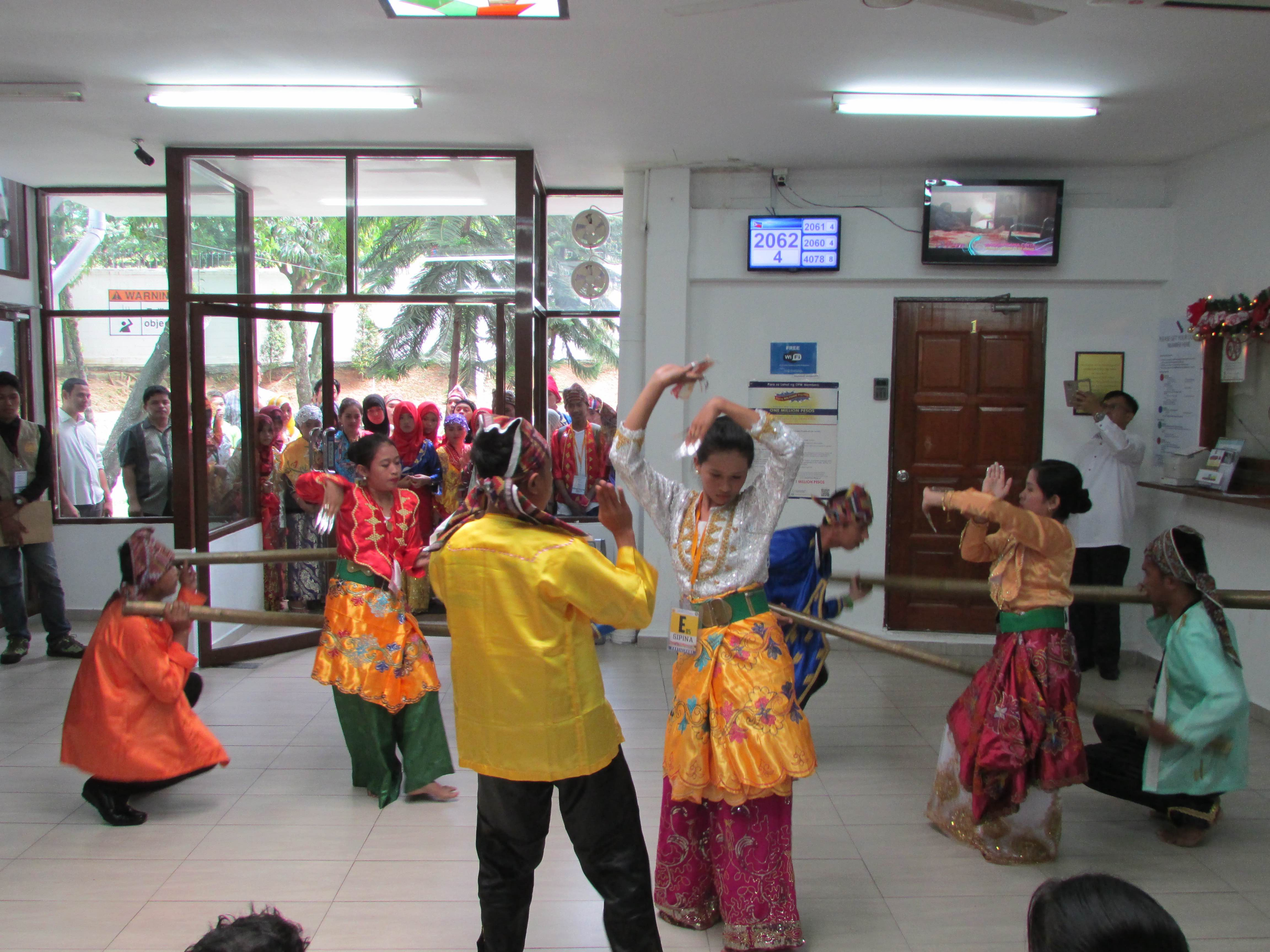 CULTURAL PERFORMANCE. Sulu Youth Leaders perform a traditional dance at the consular section of the Philippine Embassy, much to the delight of Filipinos applying for passports and other consular services. Photo from the Philippine Embassy in Kuala Lumpur