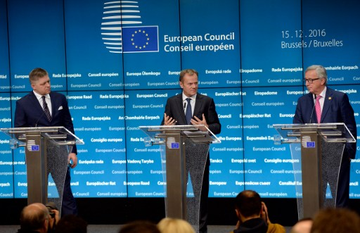 EU SUMMIT. European Union Commission President Jean-Claude Juncker, right, European Union Council President Donald Tusk, center, and Slovakia's Prime Minister Robert Fico, left, talk to the media at the end of a European Union Summit held at the EU Council building in Brussels on December 15, 2016. Photo by Thierry Charlier/AFP