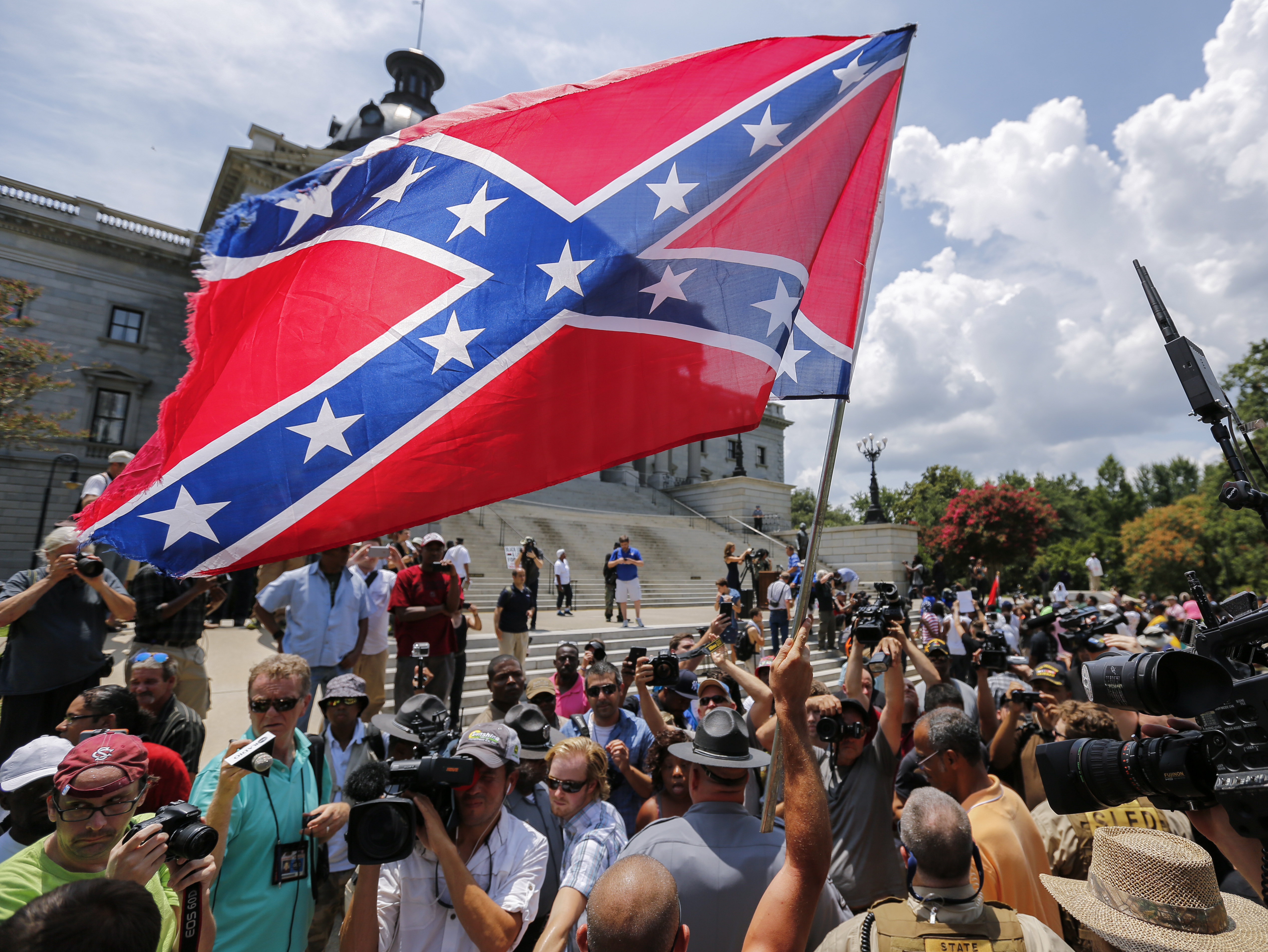 CONTROVERSY. A man displays a Confederate battle flag during New Black Panther Party and Ku Klux Klan rallies on the grounds of the South Carolina Capitol on July 18, 2015. File photo by Erik S. Lesser/EPA